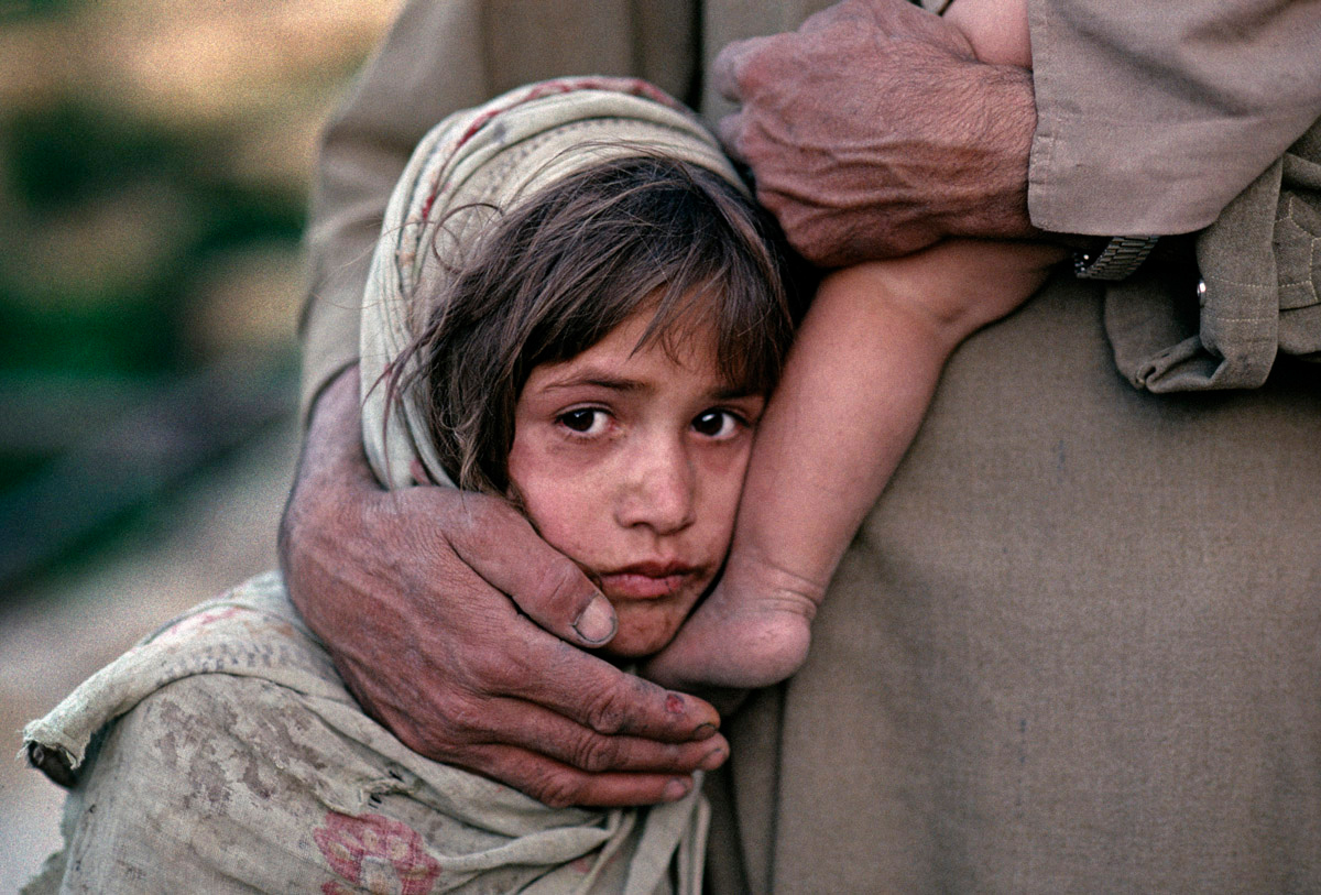 "<font size=""3""><font face=""arial"">A young refugee girl and her father near Freyzabad, Afghanistan, 1990"